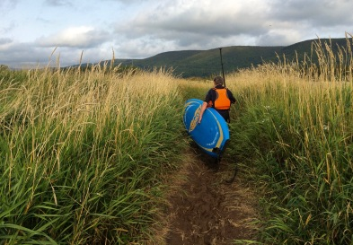 John braving the tall grasses leading to our launch point - made it feel like a real adventure!